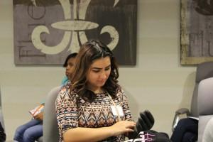 A student tries on a piece of AT&T technician safety equipment during one of the breakout sessions during a November 18 JA Job Shadow event